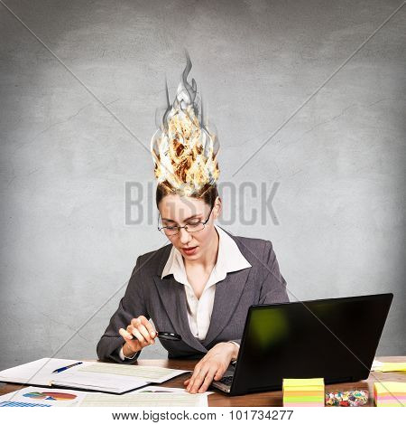 Woman having her brain on fire because of stress