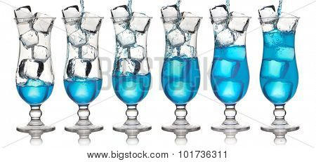Pouring Blue Curacao cocktail in glass
