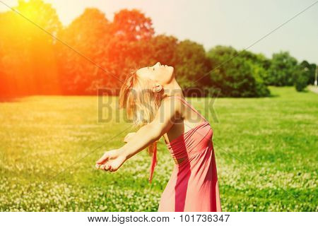 Girl with outstretched arms outdoors