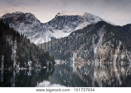Mountain Lake Against The Backdrop Of Snow-capped Mountains