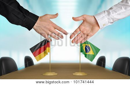 Germany and Brazil diplomats agreeing on a deal