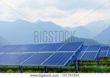 solar panels on summer landscape with mountains on background