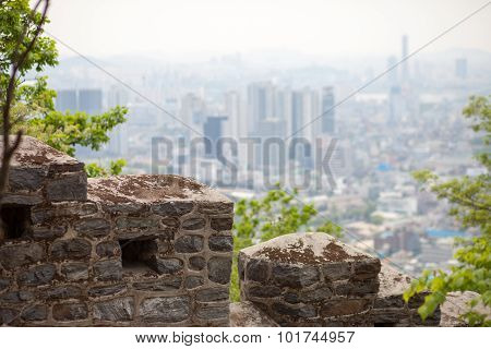 Old Wall And Modern City On The Background