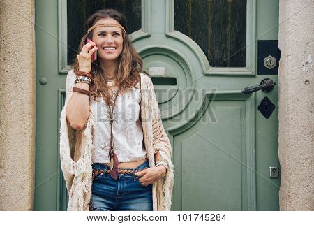 Laughing Hippie Woman In Boho Clothes Talking Cell Phone