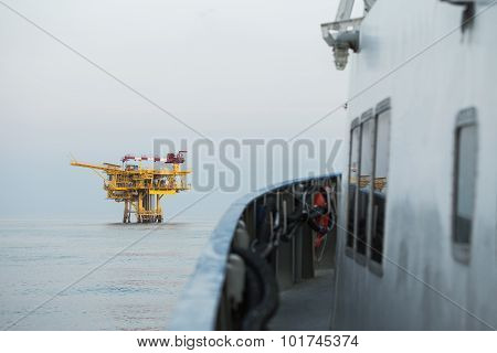 Oil and gas construction in the sea and view from supply boat, Production platform in oil and gas
