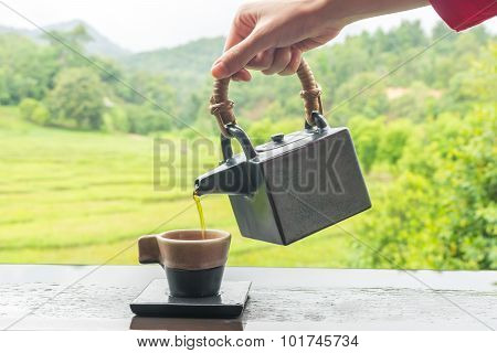 Green Tea In Cup And Teapot On Wooden Table 3
