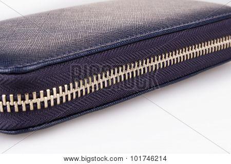 Buttoned zipper of woman wallet