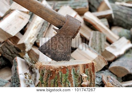 Ax In A Log On The Background Of Firewood