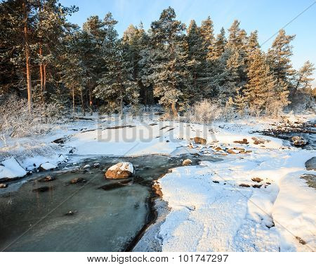 Lakeside landscape at winter morning