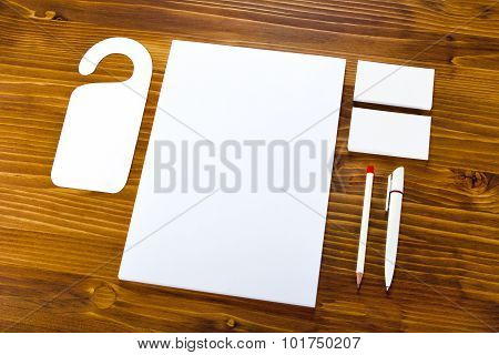 Blank Stationery On Wooden Background. Consist Of Business Cards, Letterheads, Pen And Pencil.
