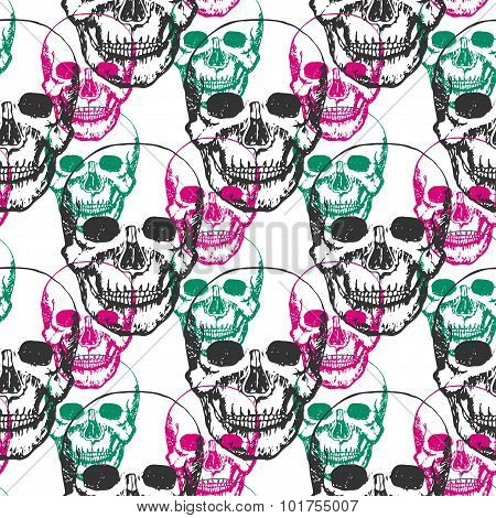 Skulls print. Skull pattern in black, pink and green color. Seamless skulls with color triangle for