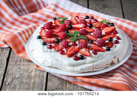 Organic homemade traditional meringue dessert sweet cake with whipper cream, strawberry, blackberry