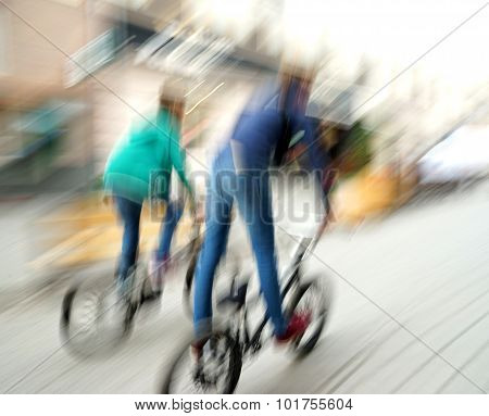 Two Teen Cyclists In Traffic