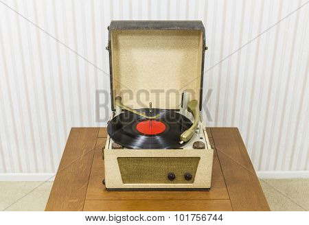 Vintage turntable with red record album.