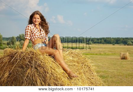 Girl Laying On  Of Straw
