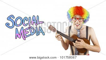 Geeky hipster in afro rainbow wig playing guitar against social media