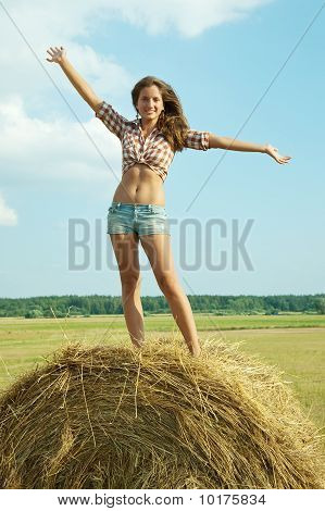 Girl Standing On Top Of  Bail