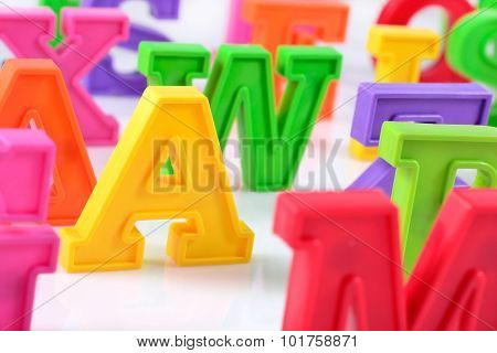 Plastic Colorful Alphabet Letters Close Up On A White