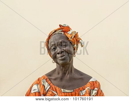 Portrait of an old lady wearing a traditional headdress