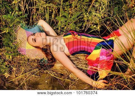 Portrait Of A Beautiful Teenage Girl Laying In The Grass