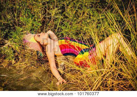 Profile Of A Beautiful Teeage Girl Laying In The Grass
