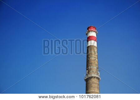 The Brick Chimney Against The Blue Sky