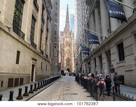 NEW YORK,USA - AUGUST 13,2015 : View of Wall Street and Trinity Church in New York