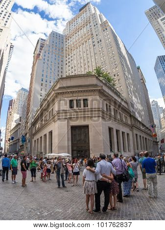 NEW YORK,USA - AUGUST 13,2015 : Tourists and locals at Wall Street near the New York Stock Exchange