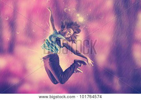 Pretty break dancer against beautiful pink forest