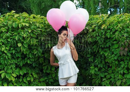 charming woman with balloons flirting