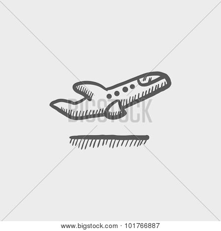 Plane taking off sketch icon for web, mobile and infographics. Hand drawn vector dark grey icon isolated on light grey background.