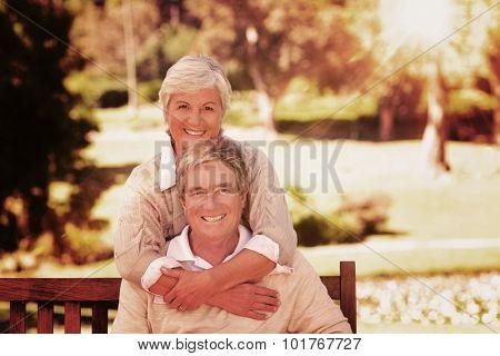 Light beam against elderly couple in the park