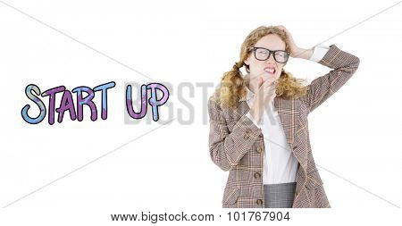 Geeky hipster thinking with hands on chin and temple against start up
