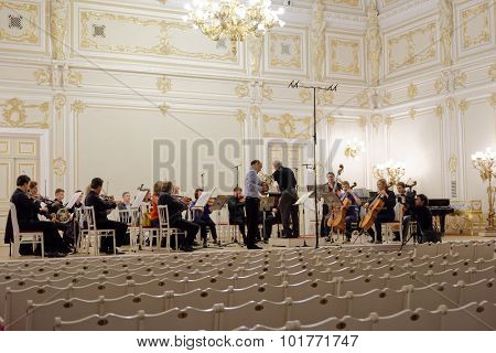 ST. PETERSBURG, RUSSIA - SEPTEMBER 7, 2015: Conductor Hermann Baumann and soloist Javier Bonet on the rehearsal with symphonic orchestra Nevsky during the International festival of French horn