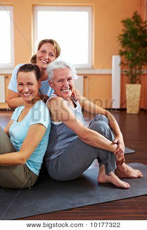 Three Smiling Women In Gym