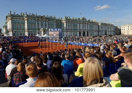 ST. PETERSBURG, RUSSIA - SEPTEMBER 12, 2015: People watching exhibition match of International tennis tournament St. Petersburg Open. The match was held on the Palace square during City's Tennis Day.