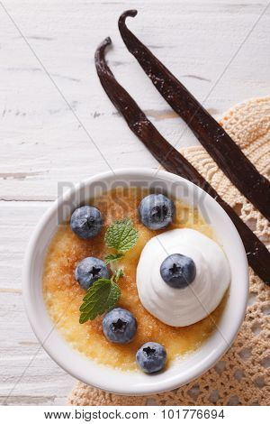 Creme Brulee Dessert With Blueberries Closeup. Vertical Top View