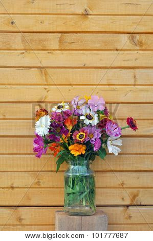 Flowers and wooden wall