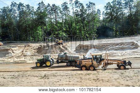 Trucks, tractors, excavators