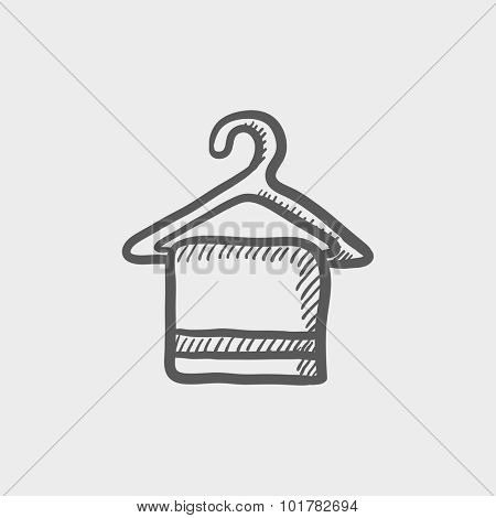 Towel on hanger sketch icon for web, mobile and infographics. Hand drawn vector dark grey icon isolated on light grey background.