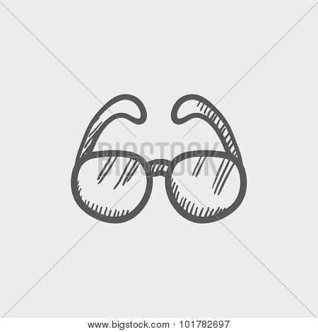 Eyeglasses sketch icon for web, mobile and infographics. Hand drawn vector dark grey icon isolated on light grey background.