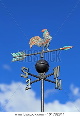 Wind Vane For Measuring Wind Direction With A Rooster And The Cardinal Points