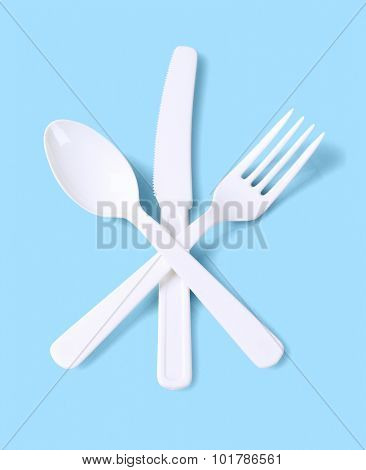 Plastic Fork Spoon and Knife on Blue Background