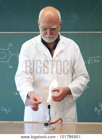 Scientists With A Bunsen Burner In A Lab