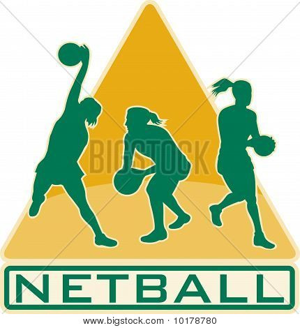 netball player catching jumping
