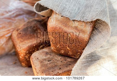 Loaf Of Rye Bread Covered With Coarse Linen Cloth