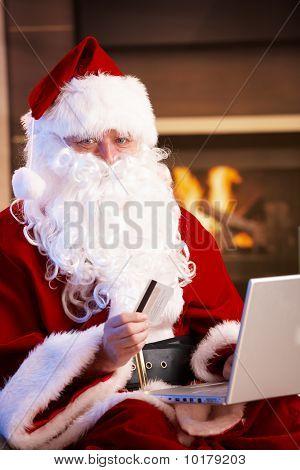 Santa Claus Paying With Credit Card