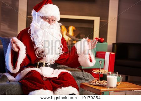 Happy Santa With Milk And Chocolate Chip Cookies
