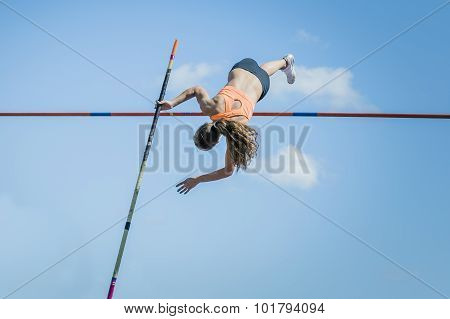 Girl athletes pole vault