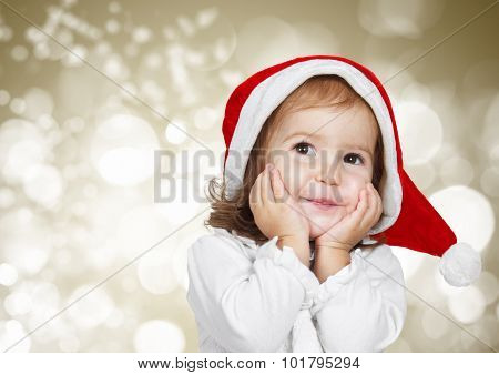 Funny Child Dressed Santa Hat, On Golden Bokeh Background
